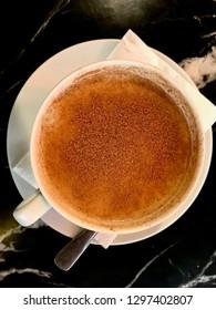 Turkish Salep or Sahlep with Cinnamon Powder / Christmas Eggnog. Traditional Organic Beverage.