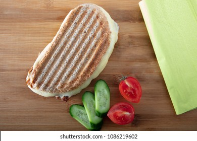 Turkish Sandwich Toast (Tost) with cheddar or melted cheese with napkin on wooden background ,top view