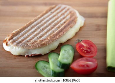 Turkish Sandwich Toast (Tost) with cheddar or melted cheese , Selective focus on wooden background high angle view