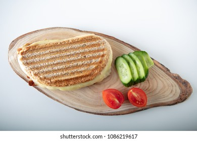 Turkish Sandwich Toast (Tost) with cheddar or melted cheese on wooden background ,top view