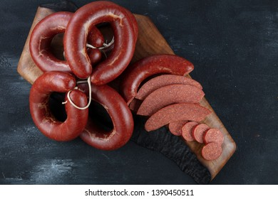 Turkish sausage kangal sucuk. Sujuk (sucuk), a dry spicy sausage on wooden background.