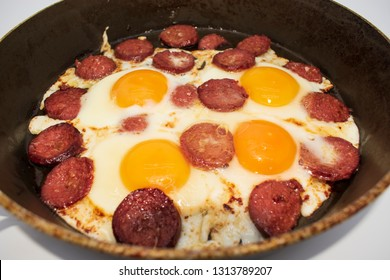 Turkish Sausage (sucuk) and egg. Turkish sausage and egg in pan on white background