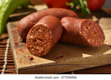 Turkish sausage sucuk on a cutting board