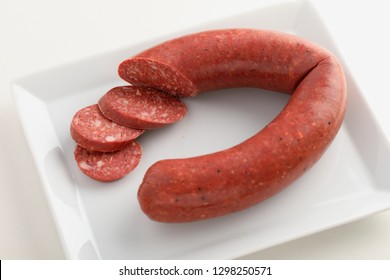 Turkish sausage sucuk on a white dish