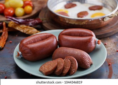 Turkish sausages Sucuk, fried eggs, and spices