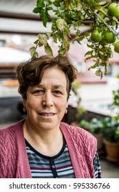 Turkish Senior Woman Portraid with Greed Tomatoes