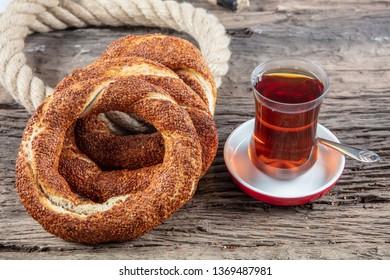 Turkish Simit on the wooden background for breakfast.Turkish bagel (simit, gevrek) and tea.