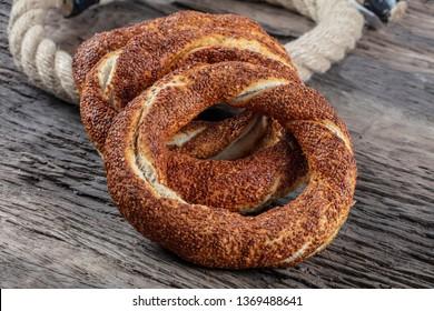 Turkish Simit on the wooden background for breakfast.Turkish bagel (simit, gevrek).