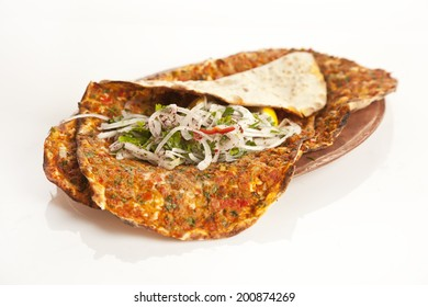Turkish specialty pizza lahmacun pide  with parsley and lemon isolated white backgorund