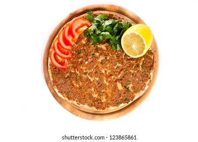 Turkish specialty pizza with parsley and lemon