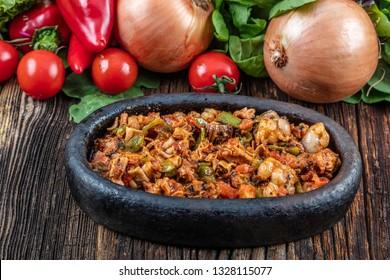 Turkish Street Food Kokorec made with sheep bowel cooked in wood fired oven. Kokorec kebab casserole.
