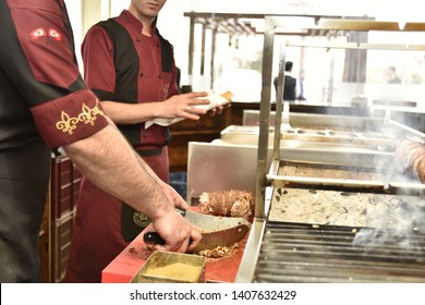 Turkish Street Food Kokorec is made from sheep intestine cooked in wood fire. Kokorec kebab stew. A delicious roasted street meal