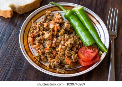 Turkish Street Food Kokorec with Tomato and Green Pepper. (Portion Sheep Bowel)