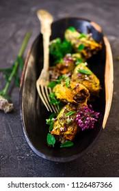 Turkish  stuffed zucchini flowers .selective focus. style rustic
