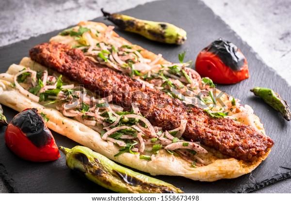 Turkish style Adana Kebab. Traditional Turkish Food Adana Kebab on presentation stone.