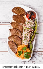 Turkish style fermented spicy fried sausage, sucuk on white plate