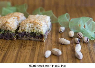 Turkish style vegan baklava or Antep baklava with walnut, pistachio for presentation and service and food photography.