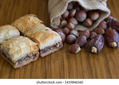 Turkish style vegan baklava or Antep baklava with nut,date fruit, pistachio for presentation and service and food photography.