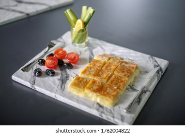 Turkish Su Boregi. pastry tray (su böregi, su borek).  Tabla borek or burek. Example of Turkish cuisine.