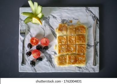 Turkish Su Boregi. pastry tray (su böregi, su borek).  Tabla borek or burek. Example of Turkish cuisine.