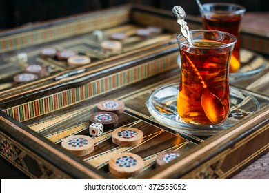 Turkish sweets and tea on the backgammon Board