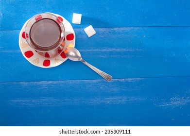 Turkish tea in classic cup and serving