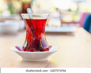 Turkish tea cup and classic tea cup mat on wooden table