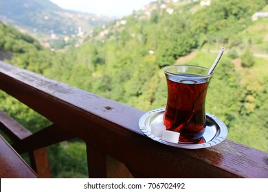 Turkish tea cup on the background of mountain landscape. Travel to Trabzon. Happy morning. A cup of traditional Turkish tea