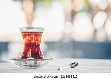 Turkish tea outdoor. Turkish cuisine and travel  concept. Horizontal, light cool toning