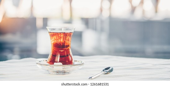 Turkish tea outdoor. Turkish cuisine and travel  concept. Horizontal, wide screen banner format, light cool toning