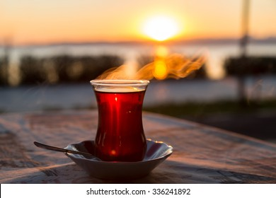 Turkish tea with reverse light image during the sunset for design