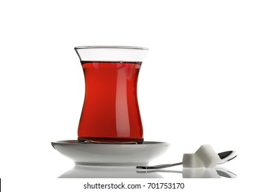 Turkish tea served in traditional glass isolated on white background.