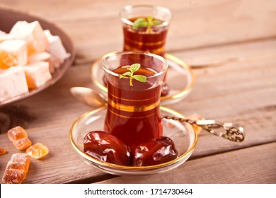 Turkish tea in traditional glass cups on the metal tray. Oriental.