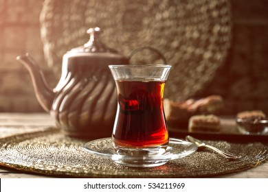 Turkish tea in traditional glass on tray closeup