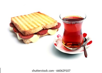 Turkish toast with a cup of black tea on a white background