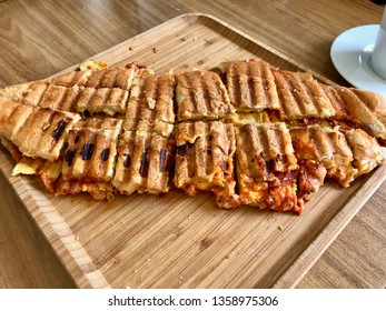 Turkish Toast Cut into Pieces /Fried Sandwich Tost Slices on Wooden Plate.