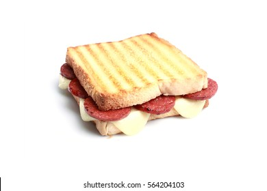 """Turkish toast with """"sucuk and cheese"""" on white background."""