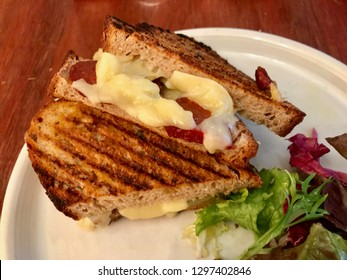 Turkish Tost / Toast Sandwich with Melted Cheese and Sucuk / Sujuk served with Salad.