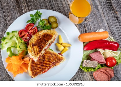 Turkish Tost / Toast Sandwich with Melted Cheese and Sucuk / Sujuk, served with Salad.