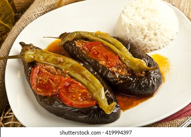 Turkish Traditional Aubergine Eggplant Meal - Karniyarik (Riven Belly) with rice pilav