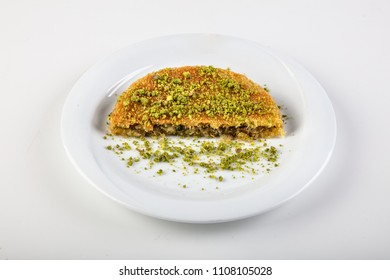 Turkish traditional and delicious dessert (Kunefe) with cheese and pistachio