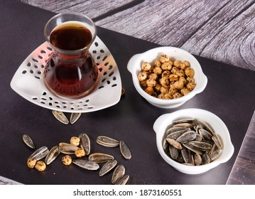turkish traditional delicious, tea and nuts, wood background on the tea and nuts, turkey country pleasure tea