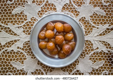 Turkish Traditional Dessert Lokma on a Rustic Tablecloth.