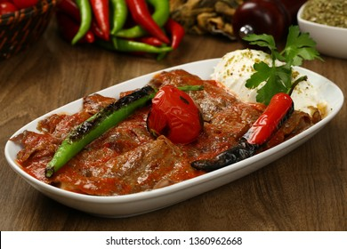 Turkish Traditional İskender Doner Kebab with butter, tomato sauce and yoghurt