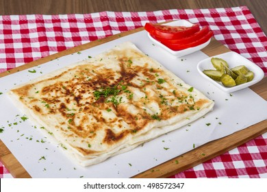 Turkish traditional Gozleme pita potatoes with cucumber and sliced tomato