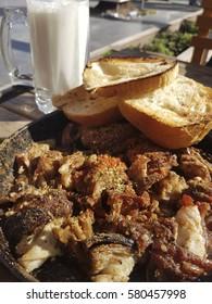 Turkish Traditional Kokorec - lamb intestine food portion with guvec