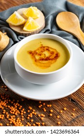 Turkish Traditional Lentil Soup with bread on white rustic wooden background. / mercimek, ezogelin corbasi