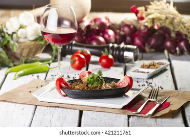 Turkish traditional Meat Tandir in Guvec with Red Wine