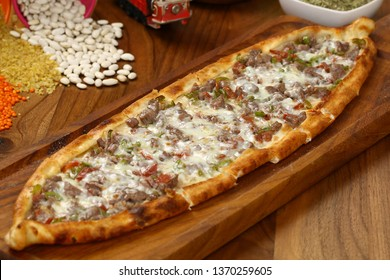 Turkish traditional pide with cheese, eggs and meat