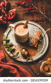 Turkish traditional wintertime hot drink Salep. Mug of Turkish sweet warming Salep drink with ground cinnamon over rustic rusty table background. Turkish seasonal cuisine, Christmas and New Year mood